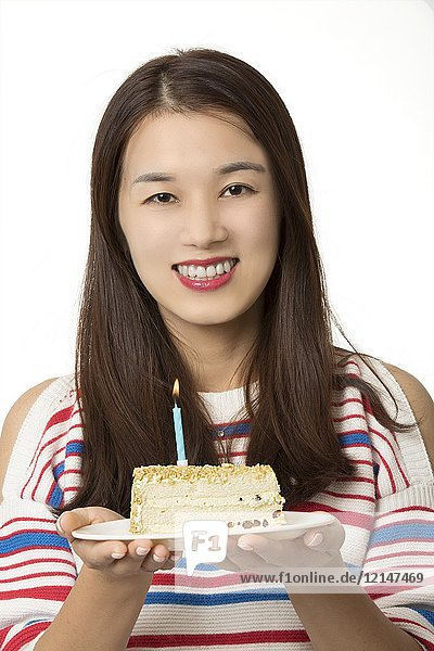 Beautiful Asian woman holding a birthday cake isolated on a white background.