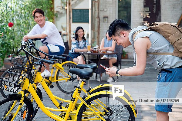 Young people ride bicycles