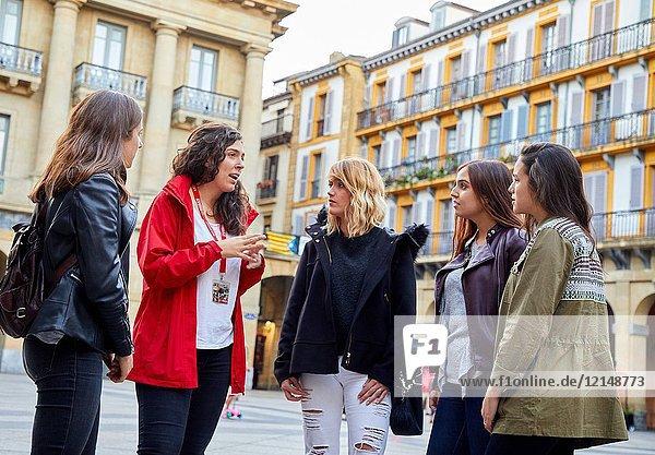 Group of tourists and guide making a tour of the city  Plaza de La Constitución  Old Town  Donostia  San Sebastian  Gipuzkoa  Basque Country  Spain  Europe