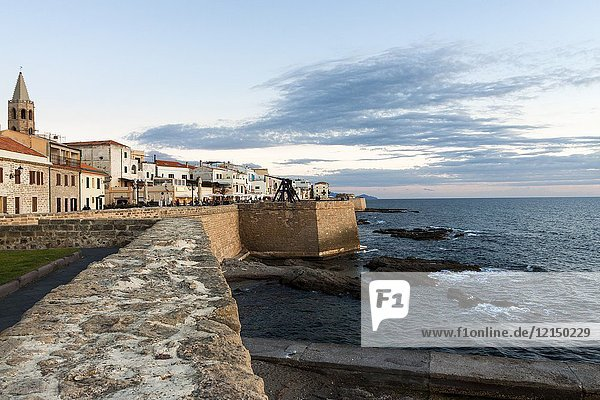 Scenic view of waterfront and an romantic sky during sunset. Alghero  Sardinia. Italy.