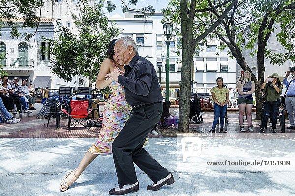 Argentina  Buenos Aires  San Telmo Plaza Dorrego  tango dancers  senior  Hispanic  man  woman  couple  dancing  audience  performance  Argentinean Argentinian Argentine
