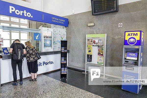 Portugal  Porto  Campanha  Railway station  train  terminal  official tourism office  counter  man  woman  ATM machine  help desk