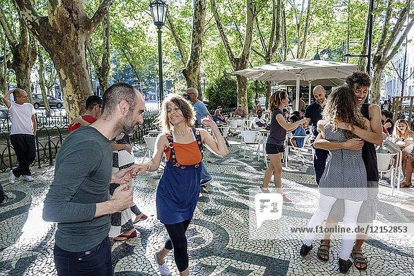 Portugal  Lisbon  Avenida Da Liberdade  promenade garden  Hispanic  man  woman  couple  dancing  Portuguese Europe EU European Hispanic