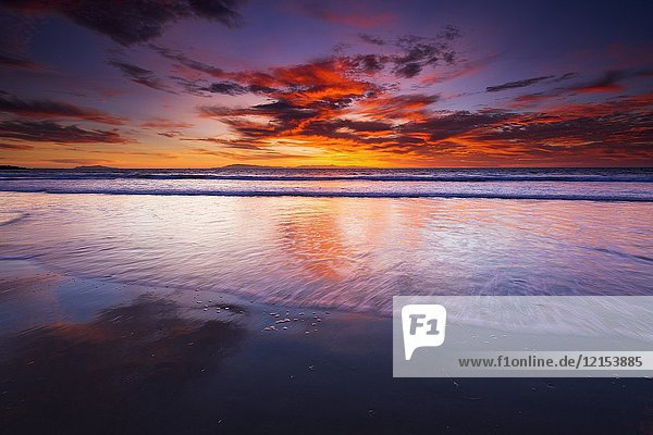 Sunset over the Channel Islands from Ventura State Beach  Ventura  California USA.