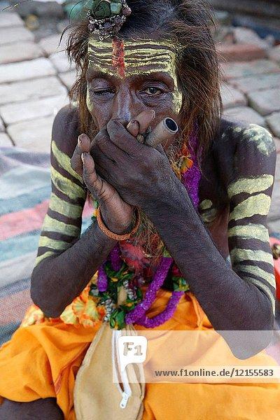 Indian sadhu smoking a chilum in Vrindavan.