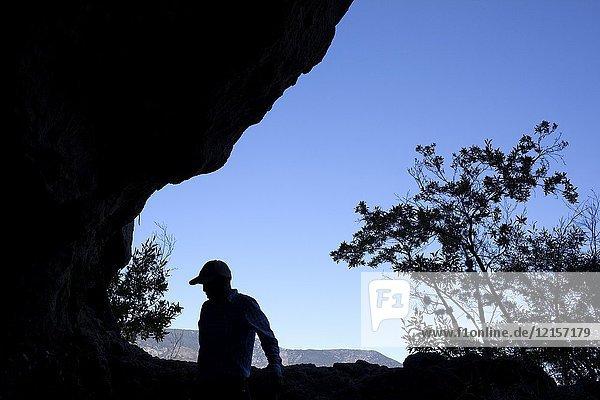 A man walks inside a cave in Union Zapata  Oaxaca  Mexico.