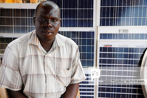 Jackson Oloya runs a shop in Bweyale.