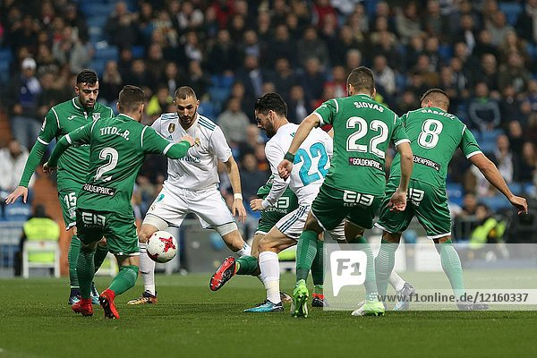 MADRID  SPAIN. January 24  2018 - Isco with the ball against Leganes defenders. Real Madrid pushed right to the end but were ultimately unable to get the better of Leganés  who scored twice  once in either half  to knock the Whites out of the Copa del Rey.Photos by Antonio Pozo | PHOTO MEDIA EXPRESS.