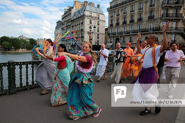 ISKCON devotees performing a harinam (devotional walk with dancing and chanting) in Paris