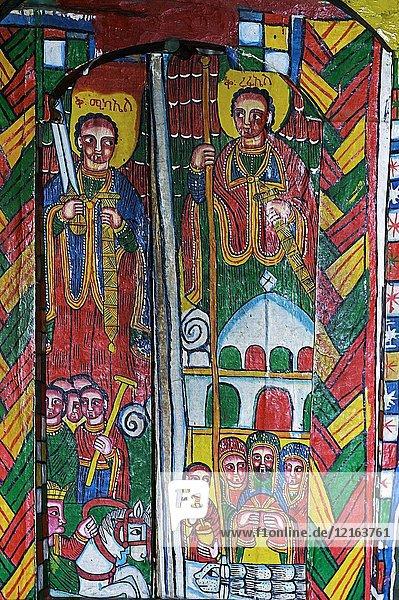 Representation of archangel Mikael (left) and archangel Raphael (right)  canvas painting  orthodox rock-hewn church Mikael Mellehayzengi  Tsaeda Amba  Tigray  Ethiopia.