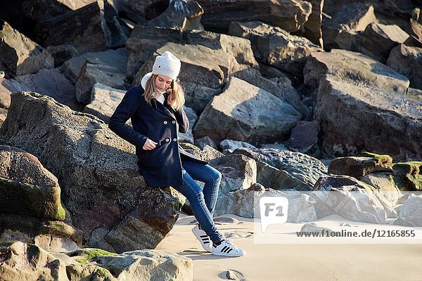 Adult woman on the beach  Santa Clara Island  Donostia  San Sebastian  Gipuzkoa  Basque Country  Spain  Europe  Winter