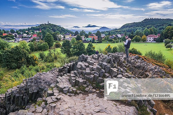 Aerial view from columnar jointed basalt rock formation called Panska Skala (The Lord's Rock) or Pipe Organ in Kamenicky Senov town in Czech Republic.
