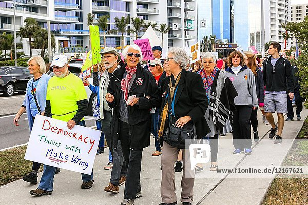 People at the Women's March in downtown Sarasota FL  part of a US wide demonstration against Donald Trump and global Me Too issues.