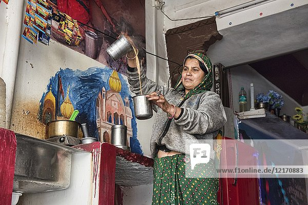 Pouring hot chai  the national beverage of India  Bundi  Rajasthan  India.