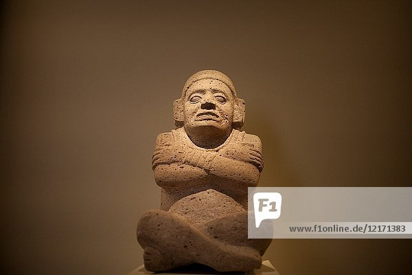 An sculpture of a man sitting and with his arms crossed is displayed in Museo Amparo  in Puebla de los Angeles  Mexico.