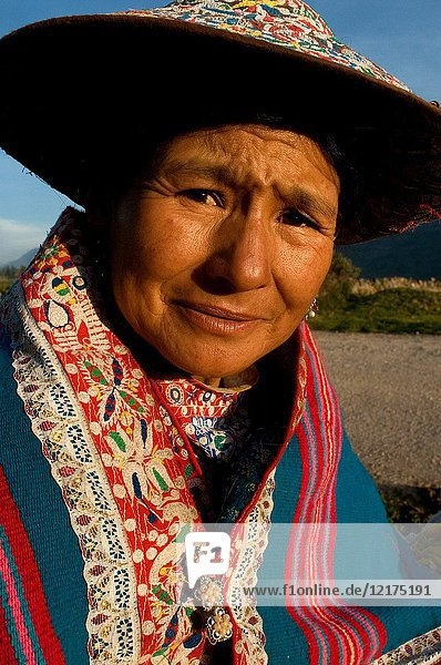 A woman dressed in typical regional costumes from the Colca Valley area  Chivay  Peru.