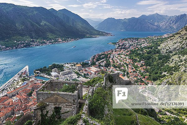 Ancient Old Town ruins around Saint John Fortress in Kotor coastal city in Bay of Kotor of Adriatic Sea  Montenegro. Dobrota town on background.