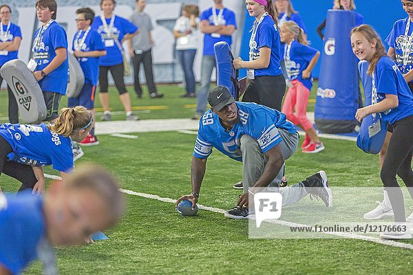 Detroit  Michigan - Detroit Lions linebacker Tahir Whitehead runs students through football drills during a physical activity and nutrition program at Ford Field. The program  Fuel Up to Play 60  is sponsored by the National Dairy Council and the National Football League.