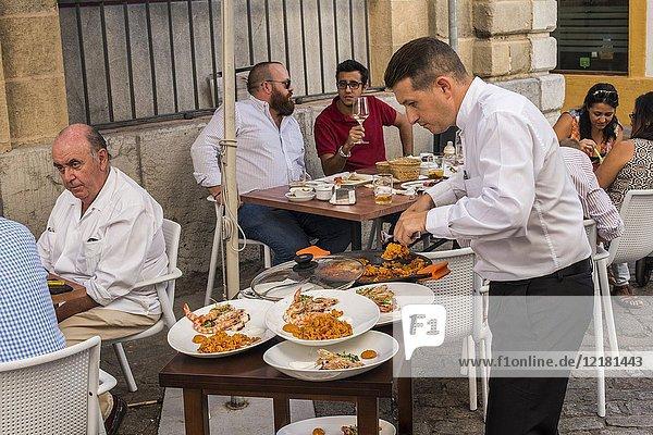 People enjoying outdoor dining in the street in Jerez de la Frontera  Cadiz province  Andalucia  Spain.