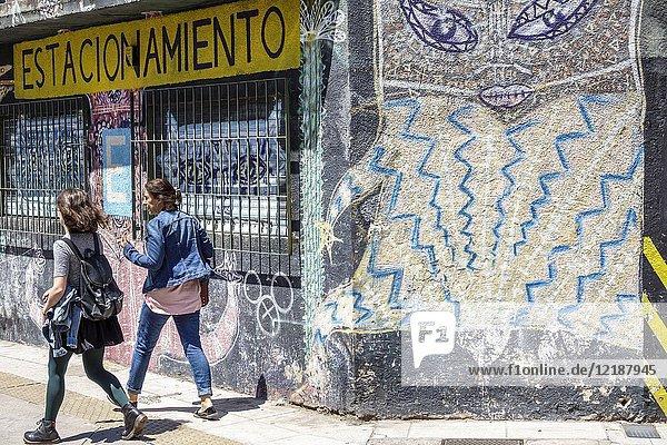 Argentina  Buenos Aires  San Telmo  sidewalk  woman  girl  teen  street art  graffiti  walking  Hispanic  Argentinean Argentinian Argentine South America American