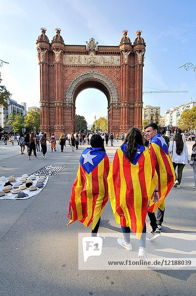 Political demonstration for the independence of Catalonia. Estelades  Catalan independent flags. October 2017. The Arc de Triomf  Triumphal Arch. Built for the Exposición Universal de Barcelona (1888)  as its main access gate by architect Josep Vilaseca i Casanovas. Built in reddish brickwork in the Moorish Revival style. Barcelona. Catalonia. Spain