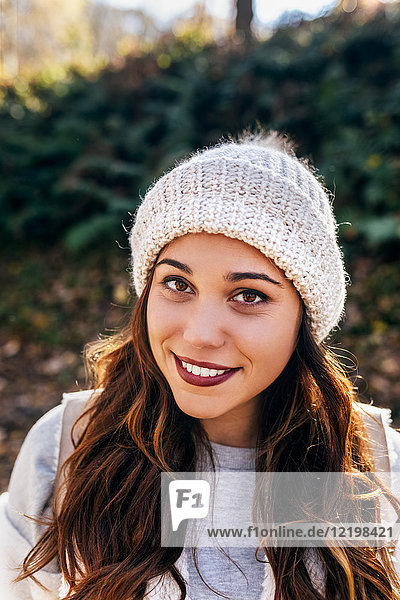 Portrait of a beautiful smiling woman wearing wooly hat