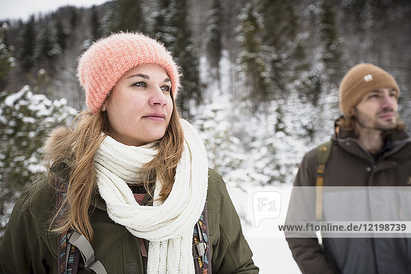Couple on a trip in winter looking around