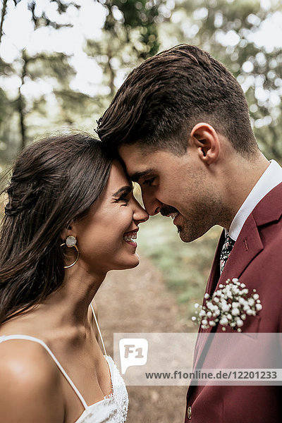 Happy wedding couple head to head looking at each other