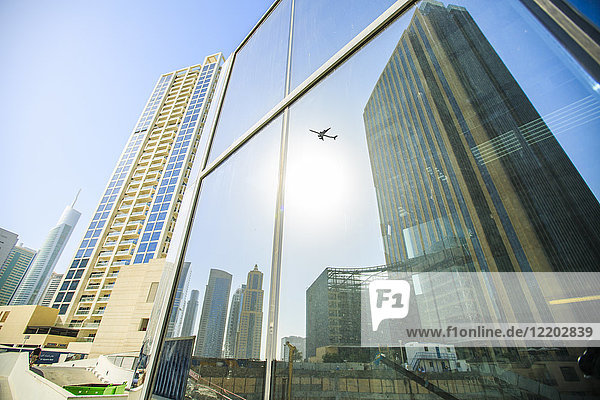 United Arab Emirates  Dubai  mirrored airplane in glass facade