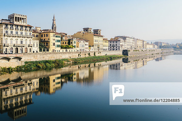 Reflection of buildings on River Arno  Florence  Tuscany  Italy  Europe