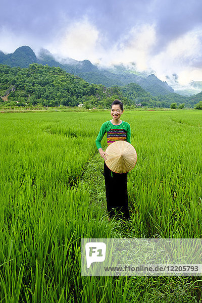 Local White Tai indigenous woman in traditional clothing standing in rice fields  Mai Chau  Hoa Binh  Vietnam  Indochina  Southeast Asia  Asia