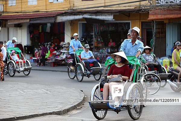 Transportation by cyclo  Vietnamese pedicab  Hoi An  Vietnam  Indochina  Southeast Asia  Asia