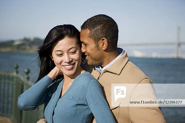 Couple hugging at waterfront