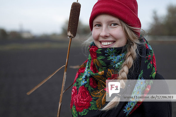 Portrait of smiling Caucasian woman wearing scarf and stocking-cap
