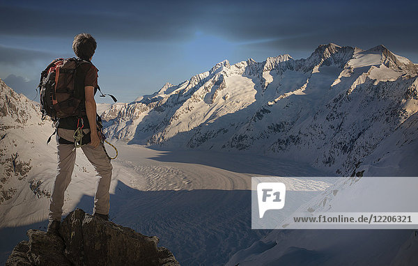 Caucasian man hiking on snowy mountain