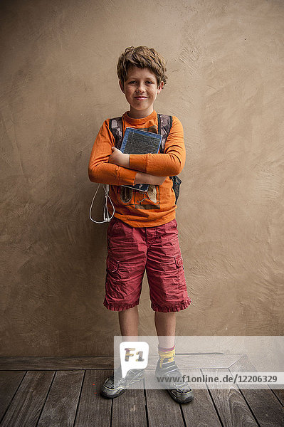 Portrait of smiling Caucasian boy holding book