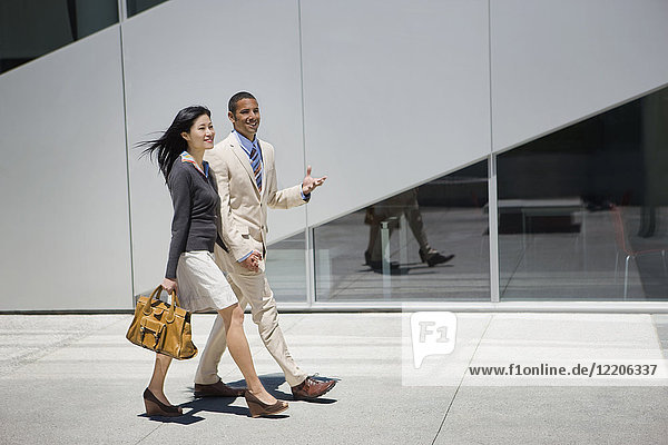 Business people walking and talking outdoors