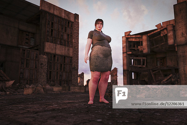 Overweight woman standing in urban ruins