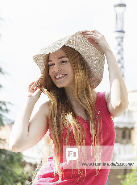 Portrait of smiling Caucasian woman wearing hat