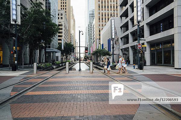 Friends crossing street in city