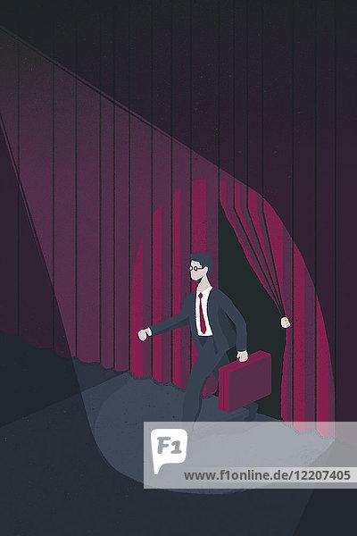 Scheinwerferlicht auf einem Geschäftsmann auf der Bühne