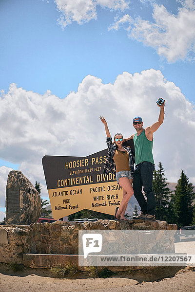 Portrait of couple by Continental Divide sign  Breckenridge  Colorado  USA