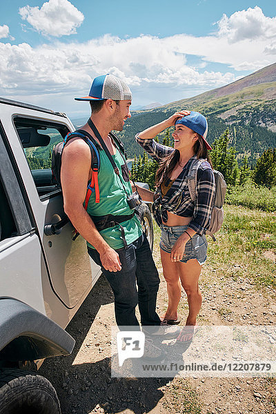 Road trip couple leaning against off road vehicle in Rocky mountains  Breckenridge  Colorado  USA