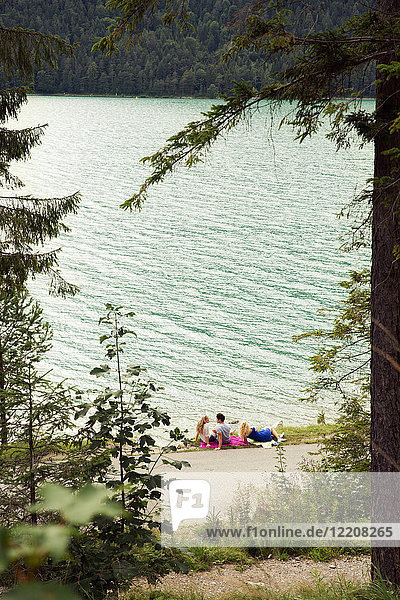 Friends relaxing by Achensee  Innsbruck  Tirol  Austria  Europe