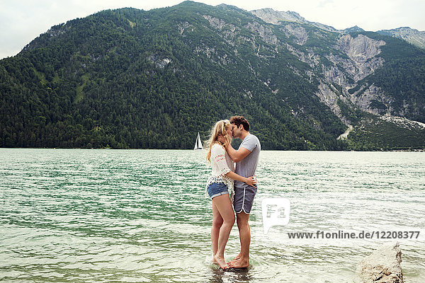 Couple in shallow water kissing  Achensee  Innsbruck  Tirol  Austria  Europe