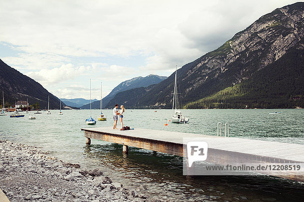 Couple on pier  Achensee  Innsbruck  Tirol  Austria  Europe