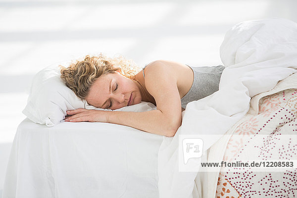 Woman at home  sleeping in bed