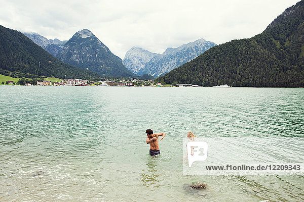 Couple waist deep in water  Achensee  Innsbruck  Tirol  Austria  Europe