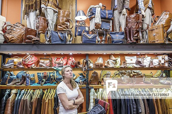 Argentina  Buenos Aires  Galerias Pacifico mall  shopping  El Boyero  Argentine leather goods  handbags  travel bags  coats  woman  looking  Hispanic  Argentinean Argentinian Argentine South American America