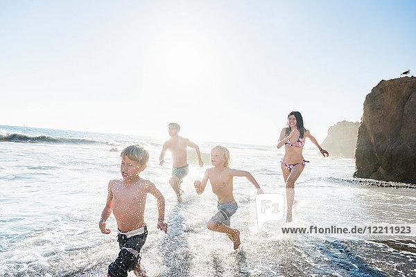 Family playing on El Matador Beach  Malibu  USA